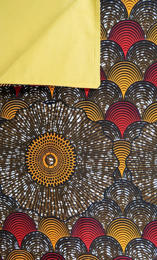 copripiumino conchiglia realizzato con stoffa wax in cotone originaria della Tanzania scatto 4