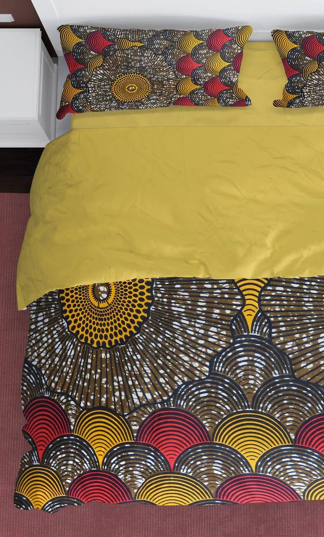 copripiumino conchiglia realizzato con stoffa wax in cotone originaria della Tanzania scatto 1