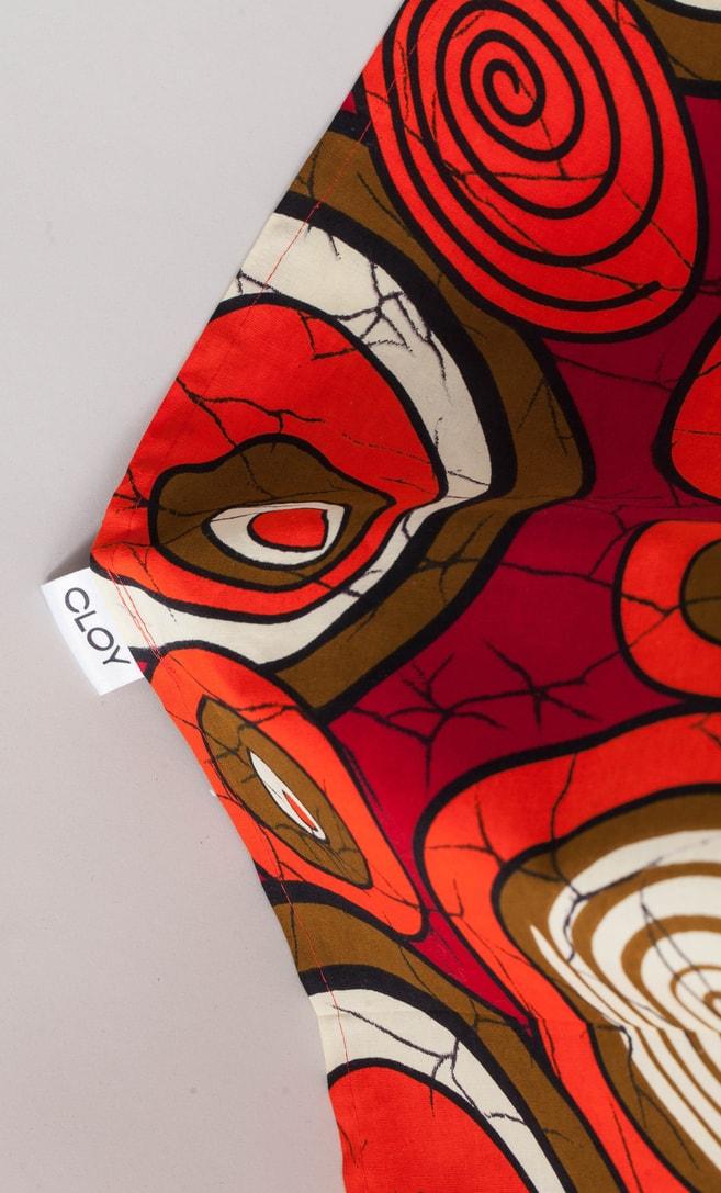 copriletto chiocciola realizzato con stoffa wax in cotone originaria della Tanzania scatto 2