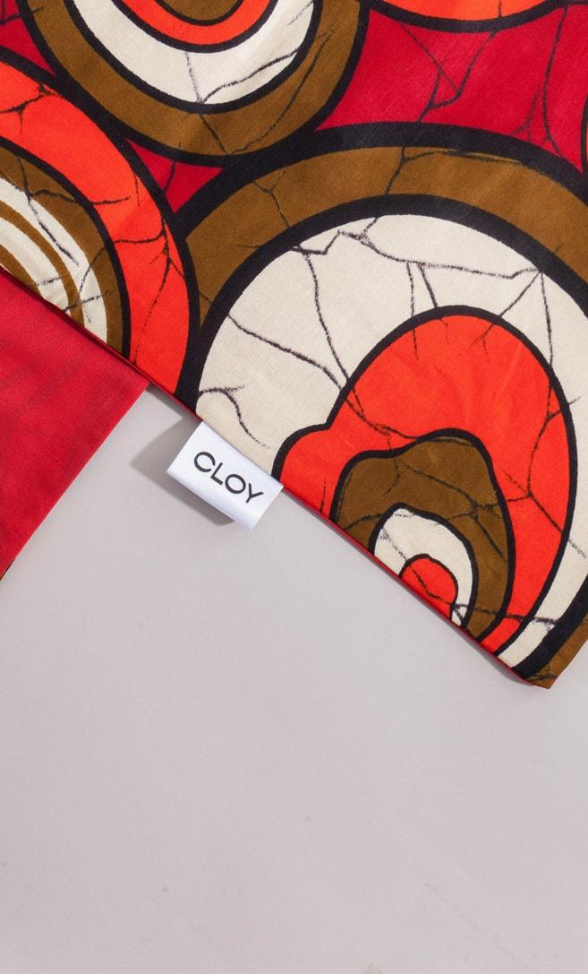copriletto chiocciola realizzato con stoffa wax in cotone originaria della Tanzania scatto 4